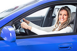 Woman driving a blue car